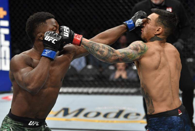 LAS VEGAS, NEVADA - JANUARY 18: (L-R) Ode Osbourne trades punches with Andre Fili in their featherweight fight during the UFC 246 event at T-Mobile Arena on January 18, 2020 in Las Vegas, Nevada. (Photo by Jeff Bottari/Zuffa LLC via Getty Images)