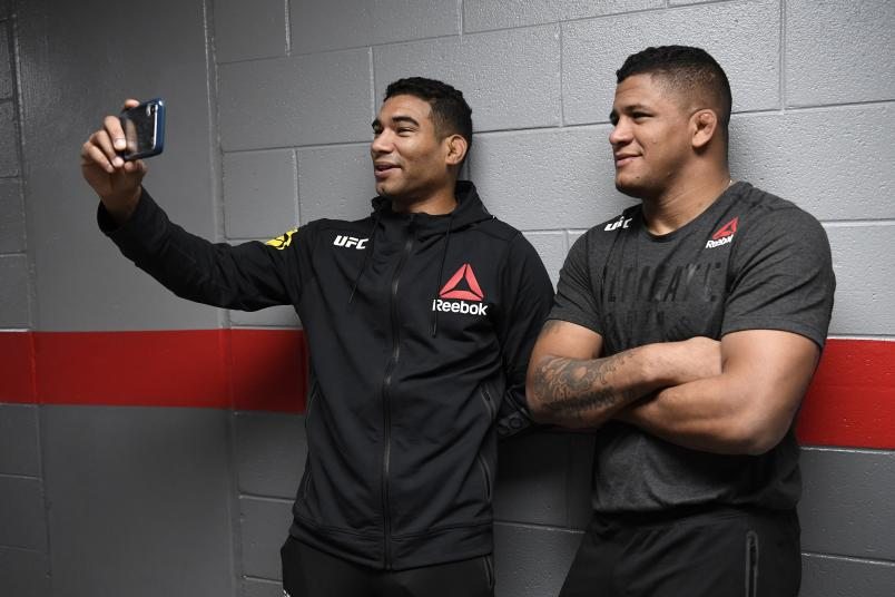 RALEIGH, NORTH CAROLINA - JANUARY 25: (L-R) Herbert Burns of Brazil and Gilbert Burns stand backstage during the UFC Fight Night event at PNC Arena on January 25, 2020 in Raleigh, North Carolina. (Photo by Mike Roach/Zuffa LLC)