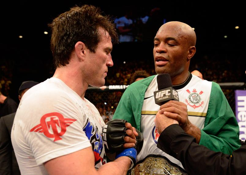 LAS VEGAS, NV - JULY 7: (R-L) Anderson Silva speaks with Chael Sonnen after he defeated him during their UFC middleweight championship bout at UFC 148 inside MGM Grand Garden Arena on July 7, 2012 in Las Vegas, Nevada. (Photo by Donald Miralle/Zuffa LLC/Zuffa LLC via Getty Images)