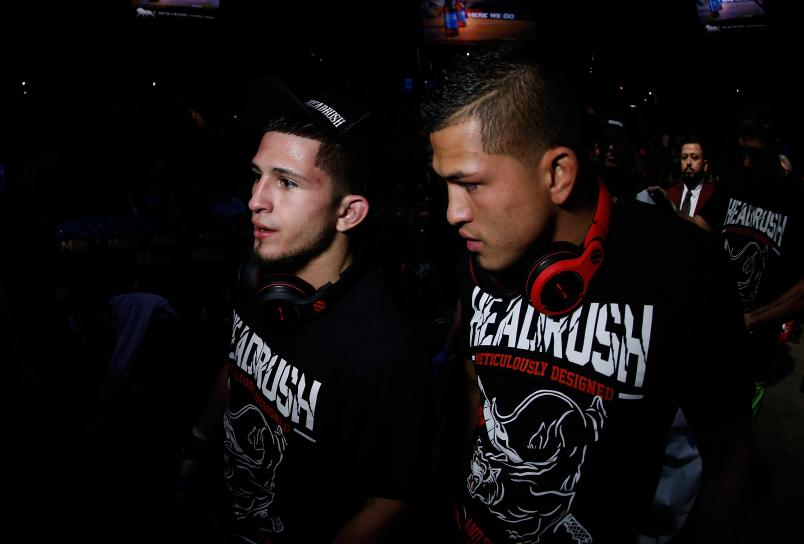 LAS VEGAS, NV - NOVEMBER 16: (L-R) Sergio Pettis and brother Anthony Pettis walk out of the Octagon during the UFC 167 event inside the MGM Grand Garden Arena on November 16, 2013 in Las Vegas, Nevada. (Photo by Josh Hedges/Zuffa LLC)