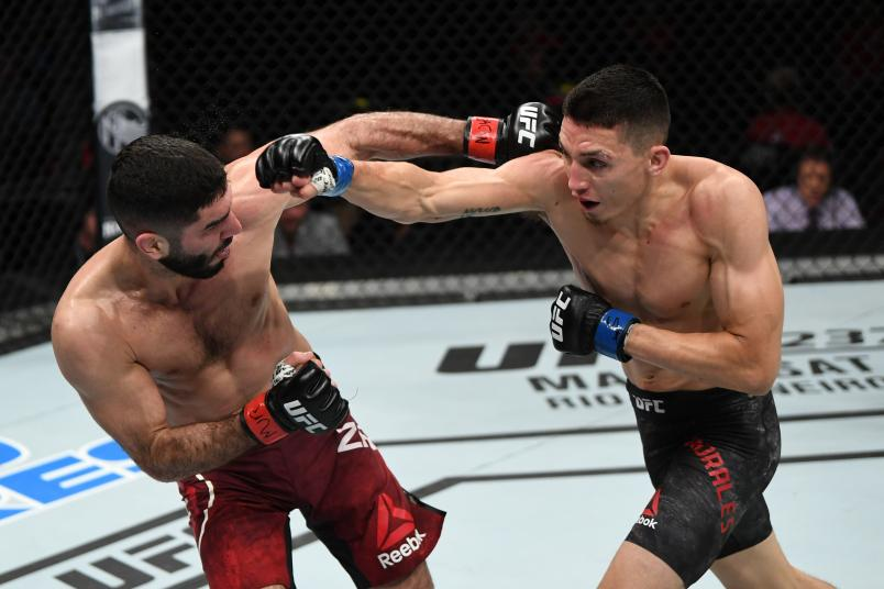 OTTAWA, ON - MAY 04: (R-L) Vince Morales punches Aiemann Zahabi of Canada in their bantamweight bout during the UFC Fight Night event at Canadian Tire Centre on May 4, 2019 in Ottawa, Ontario, Canada. (Photo by Jeff Bottari/Zuffa LLC/Zuffa LLC via Getty Images)