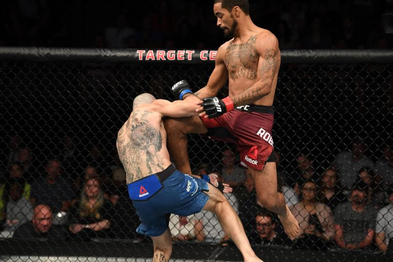 MINNEAPOLIS, MN - JUNE 29: (R-L) Roosevelt Roberts attempts a flying knee against Vinc Pichel in their lightweight bout during the UFC Fight Night event at the Target Center on June 29, 2019 in Minneapolis, Minnesota. (Photo by Josh Hedges/Zuffa LLC/Zuffa LLC via Getty Images)