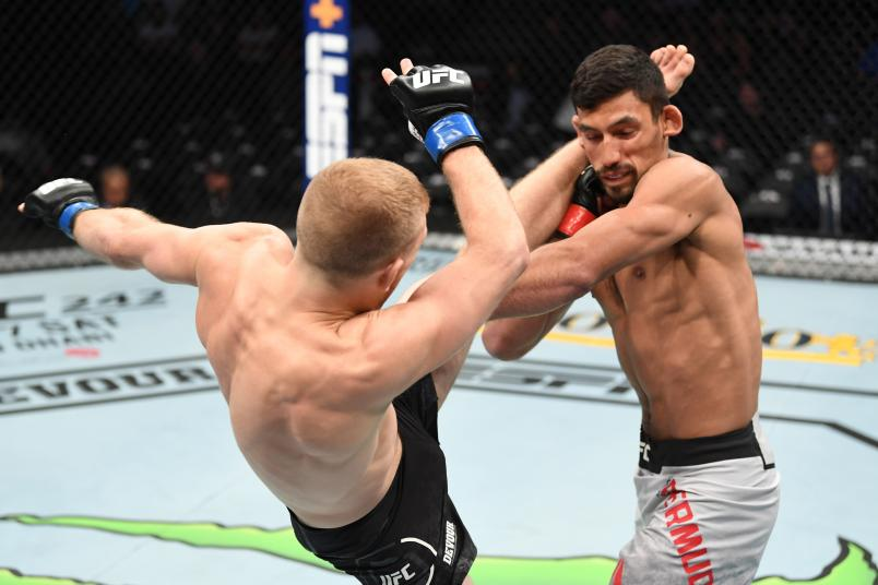 ANAHEIM, CALIFORNIA - AUGUST 17: (L-R) Casey Kenney kicks Manny Bermudez in their catchweight bout during the UFC 241 event at the Honda Center on August 17, 2019 in Anaheim, California. (Photo by Josh Hedges/Zuffa LLC/Zuffa LLC via Getty Images)