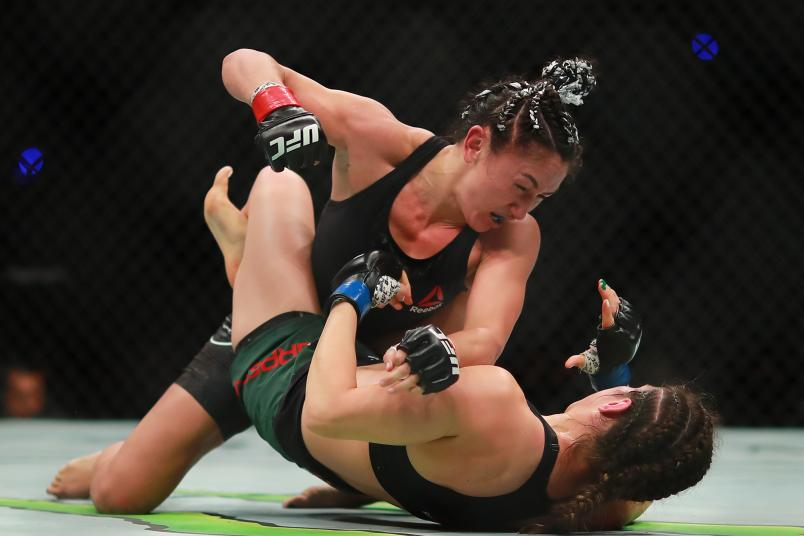 MEXICO CITY, MEXICO - SEPTEMBER 21: Carla Esparza of Mexico punches Alexa Grasso in their women's strawweight bout during UFC Fight Night event at Arena Ciudad de Mexico on September 21, 2019 in Mexico City, Mexico. (Photo by Hector Vivas/Zuffa LLC/Zuffa LLC)