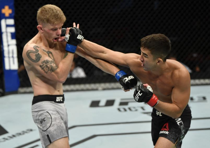 VANCOUVER, BRITISH COLUMBIA - SEPTEMBER 14: (R-L) Louis Smolka punches Ryan MacDonald in their bantamweight bout during the UFC Fight Night event at Rogers Arena on September 14, 2019 in Vancouver, Canada. (Photo by Jeff Bottari/Zuffa LLC/Zuffa LLC)