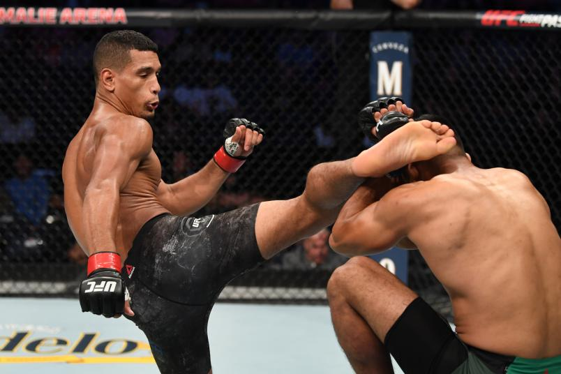 TAMPA, FLORIDA - OCTOBER 12: (L-R) Miguel Baeza kicks Hector Aldana of Mexico in their welterweight bout during the UFC Fight Night event at Amalie Arena on October 12, 2019 in Tampa, Florida. (Photo by Josh Hedges/Zuffa LLC via Getty Images)