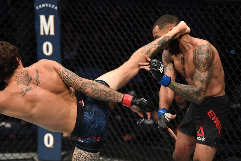TAMPA, FLORIDA - OCTOBER 12: (L-R) Marlon Vera of Ecuador kicks Andre Ewell in their bantamweight bout during the UFC Fight Night event at Amalie Arena on October 12, 2019 in Tampa, Florida. (Photo by Josh Hedges/Zuffa LLC via Getty Images)