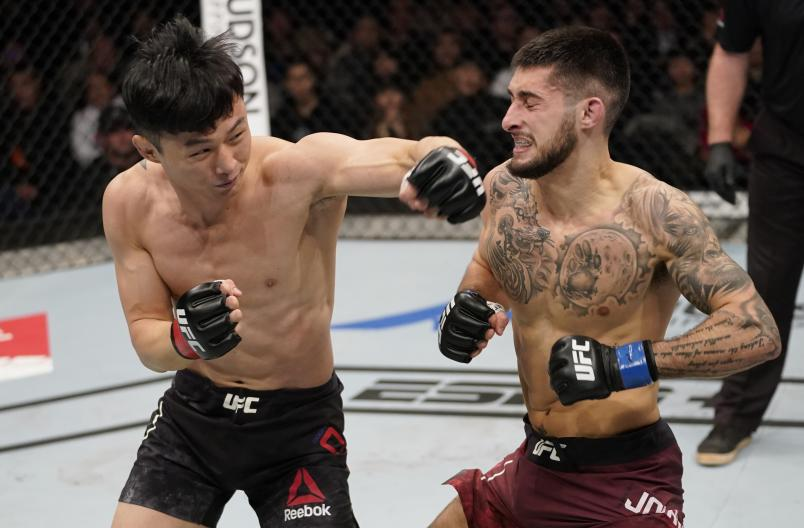 BUSAN, SOUTH KOREA - DECEMBER 21: (L-R) Dooho Choi of South Korea punches Charles Jourdain of Canada in their featherweight fight during the UFC Fight Night event at Sajik Arena 3 on December 21, 2019 in Busan, South Korea. (Photo by Jeff Bottari/Zuffa LLC)