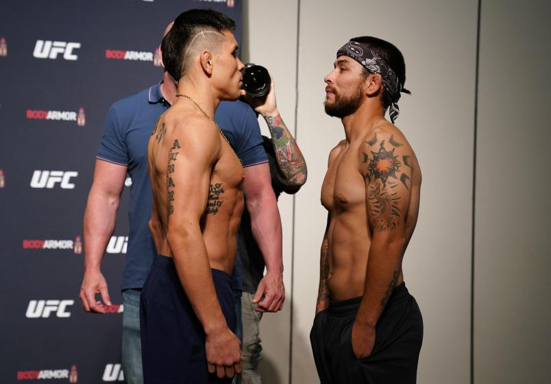 JACKSONVILLE, FLORIDA - MAY 12: (L-R) Opponents Ricky Simon and Ray Borg face off during the official UFC Fight Night weigh-in on May 12, 2020 in Jacksonville, Florida. (Photo by Cooper Neill/Zuffa LLC via Getty Images)