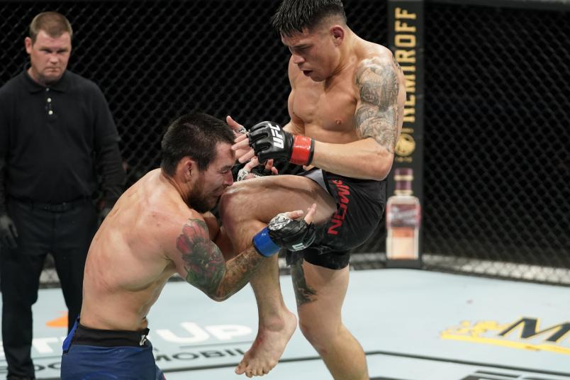 JACKSONVILLE, FLORIDA - MAY 13: (R-L) Ricky Simon knees Ray Borg in their bantamweight bout during the UFC Fight Night Event at VyStar Veterans Memorial Arena on May 13, 2020 in Jacksonville, Florida. (Photo by Cooper Neill/Zuffa LLC)