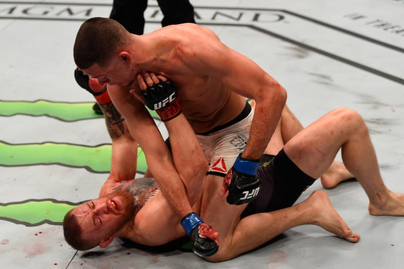 LAS VEGAS, NV - MARCH 05: Nate Diaz (top) punches Conor McGregor of Ireland in their welterweight bout during the UFC 196 event inside MGM Grand Garden Arena on March 5, 2016 in Las Vegas, Nevada. (Photo by Josh Hedges/Zuffa LLC/Zuffa LLC via Getty Images)