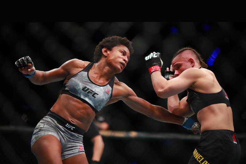 Angela Hill hits Ariane Carnelossi of Brazil in their women's strawweight bout during UFC Fight Night event at Arena Ciudad de Mexico on September 21, 2019 in Mexico City, Mexico. (Photo by Hector Vivas/Zuffa LLC)