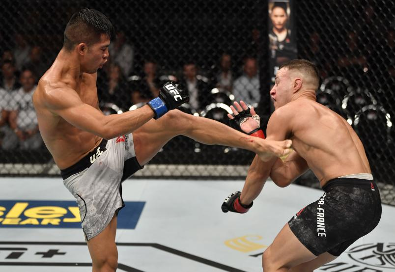 AUCKLAND, NEW ZEALAND - FEBRUARY 23: (L-R) Tyson Nam kicks Kai Kara-France of New Zealand in their flyweight bout during the UFC Fight Night event at Spark Arena on February 23, 2020 in Auckland, New Zealand. (Photo by Jeff Bottari/Zuffa LLC)