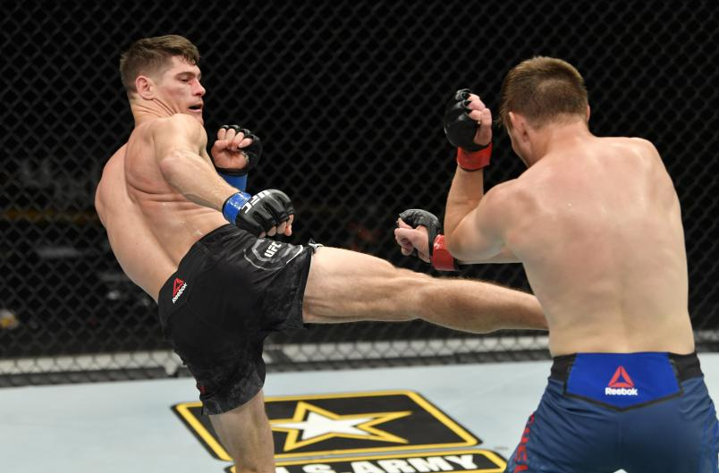 JACKSONVILLE, FLORIDA - MAY 09: (L-R) Charles Rosa kicks Bryce Mitchell in their featherweight fight during the UFC 249 event at VyStar Veterans Memorial Arena on May 09, 2020 in Jacksonville, Florida. (Photo by Jeff Bottari/Zuffa LLC)