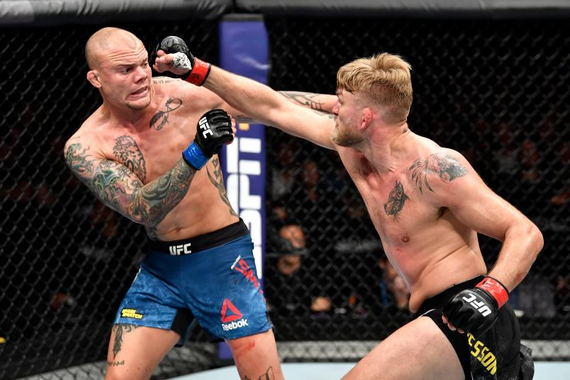 STOCKHOLM, SWEDEN - JUNE 01: (R-L) Alexander Gustafsson of Sweden punches Anthony Smith in their light heavyweight bout during the UFC Fight Night event at Ericsson Globe on June 1, 2019 in Stockholm, Sweden. (Photo by Jeff Bottari/Zuffa LLC/Zuffa LLC via Getty Images)