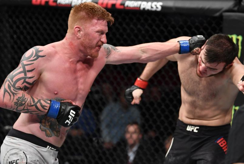 MOSCOW, RUSSIA - NOVEMBER 09: (L-R) Ed Herman punches Khadis Ibragimov of Russia in their light heavyweight bout during the UFC Fight Night event at CSKA Arena on November 09, 2019 in Moscow, Russia. (Photo by Jeff Bottari/Zuffa LLC via Getty Images)