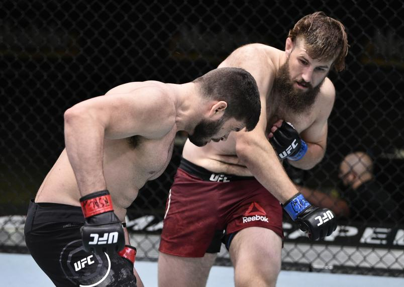 LAS VEGAS, NEVADA - JUNE 27: (R-L) Tanner Boser punches Philipe Lins of Brazil in their heavyweight fight during the UFC Fight Night event at UFC APEX on June 27, 2020 in Las Vegas, Nevada. (Photo by Chris Unger/Zuffa LLC)