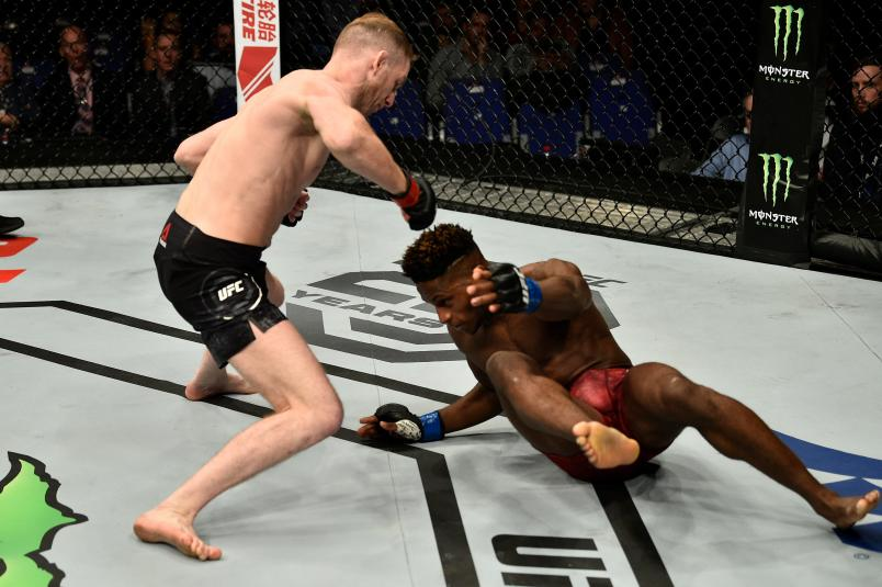 LONDON, ENGLAND - MARCH 17: (L-R) Danny Henry of Scotland knocks down Hakeem Dawodu in their featherweight bout inside The O2 Arena on March 17, 2018 in London, England. (Photo by Brandon Magnus/Zuffa LLC/Zuffa LLC via Getty Images)