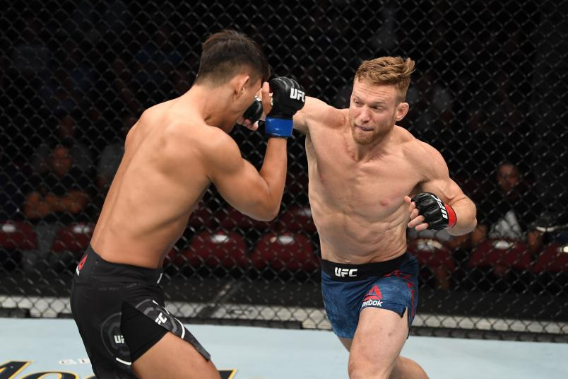 NEWARK, NJ - AUGUST 03: (R-L) Scott Holtzman punches Dong Hyun Ma of South Korea in their lightweight bout during the UFC Fight Night event at the Prudential Center on August 3, 2019 in Newark, New Jersey. (Photo by Josh Hedges/Zuffa LLC/Zuffa LLC via Getty Images)