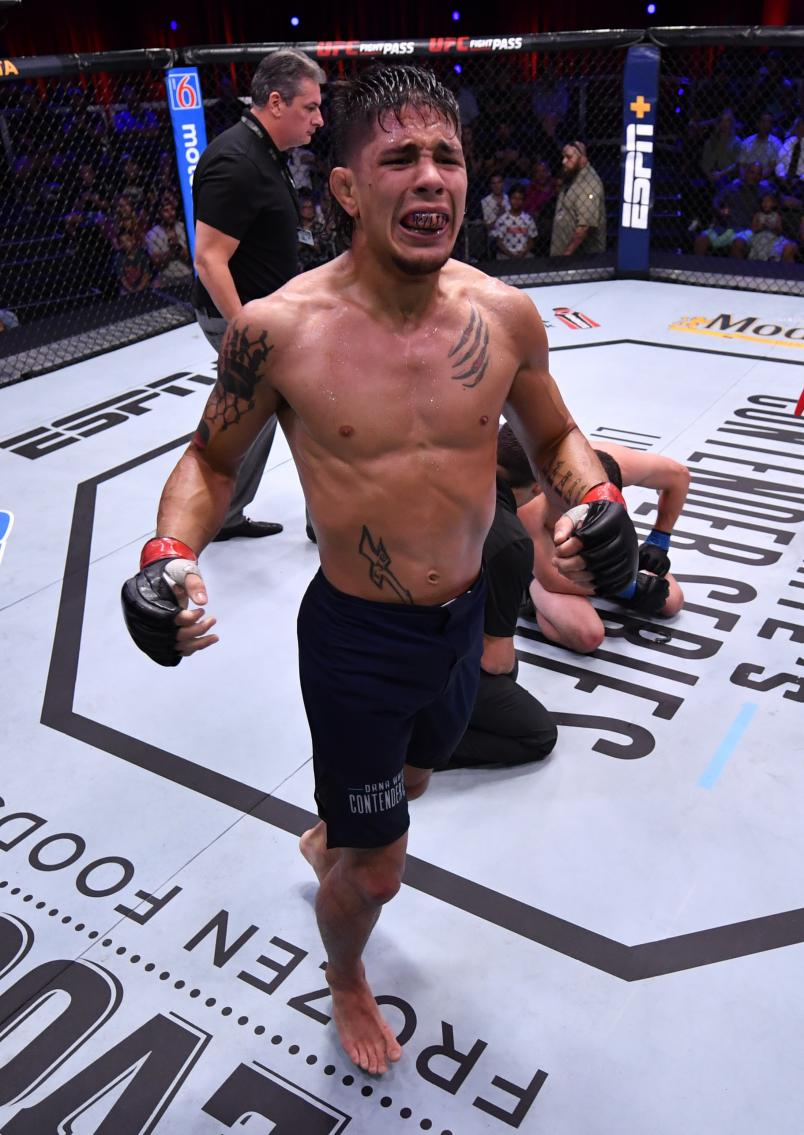 LAS VEGAS, NEVADA - AUGUST 27: TJ Brown celebrates after his submission win over Dylan Lockard in their featherweight bout during Dana White's Contender Series season three week 10 at the UFC Apex on August 27, 2019 in Las Vegas, Nevada. (Photo by Jeff Bottari/DWCS LLC/Zuffa LLC)