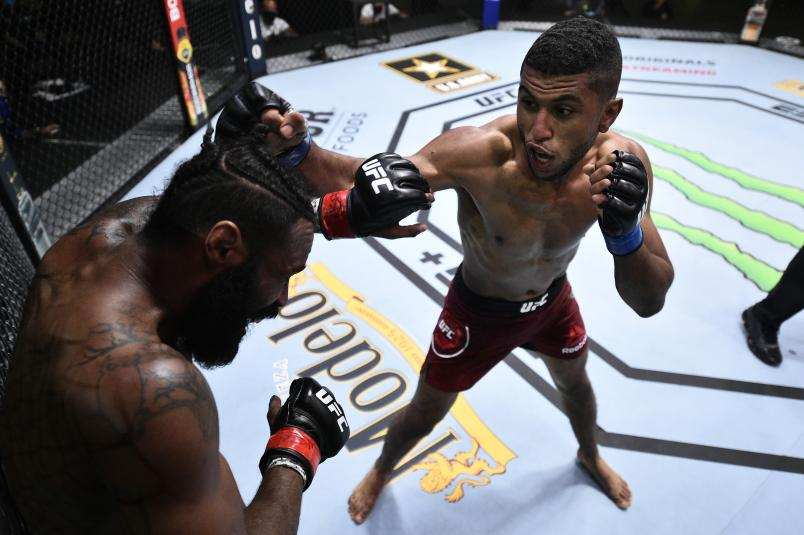 LAS VEGAS, NEVADA - JUNE 27: (R-L) Youssef Zalal of Morocco punches Jordan Griffin in their featherweight fight during the UFC Fight Night event at UFC APEX on June 27, 2020 in Las Vegas, Nevada. (Photo by Chris Unger/Zuffa LLC)