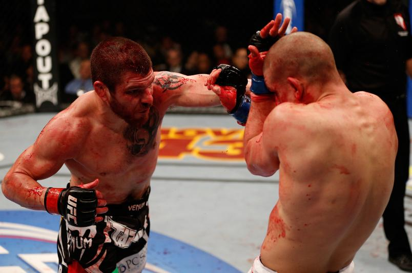 Jim Miller punches Joe Lauzon during their lightweight fight at UFC 155 on December 29, 2012 at MGM Grand Garden Arena in Las Vegas, Nevada. (Photo by Donald Miralle/Zuffa LLC via Getty Images)