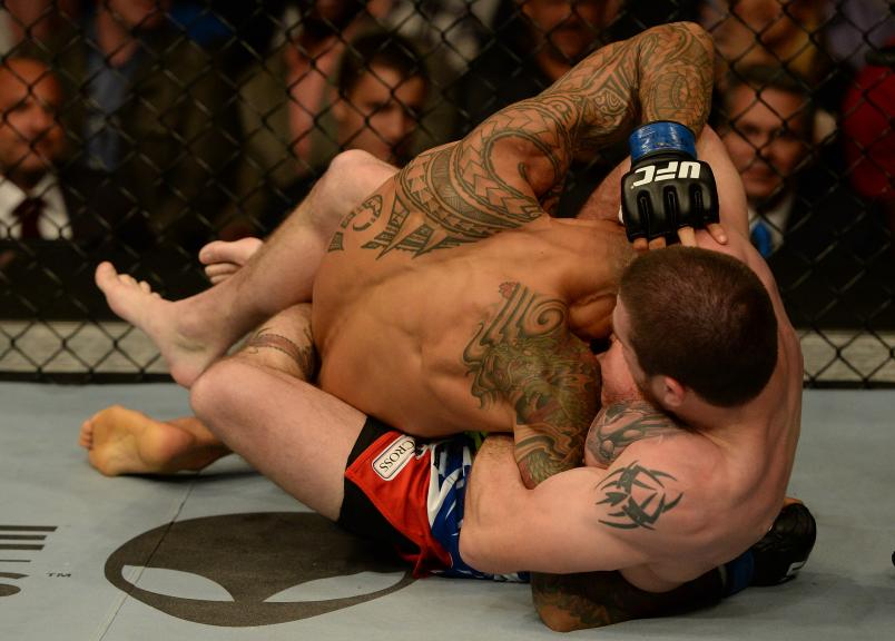 Jim Miller secures a guillotine choke submission against Yancy Medeiros in their lightweight bout during the UFC 172 event at the Baltimore Arena on April 26, 2014 in Baltimore, Maryland. (Photo by Patrick Smith/Zuffa LLC via Getty Images)
