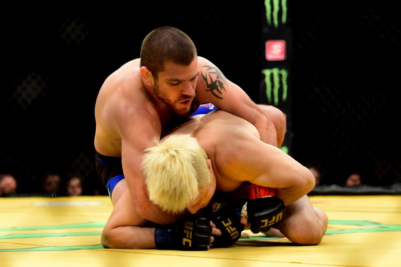 Jim Miller (top) wrestles with Takanori Gomi of Japan in their lightweight bout during the UFC 200 event on July 9, 2016 at T-Mobile Arena in Las Vegas, Nevada. (Photo by Harry How/Zuffa LLC via Getty Images)