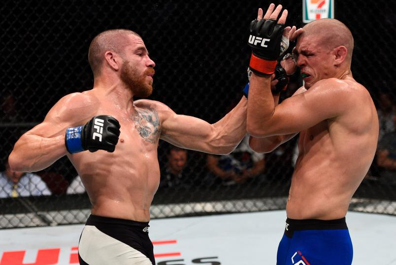 Jim Miller of the United States punches Joe Lauzon of the United States in their lightweight bout during the UFC Fight Night event at Rogers Arena on August 27, 2016 in Vancouver, British Columbia, Canada. (Photo by Jeff Bottari/Zuffa LLC via Getty Images)