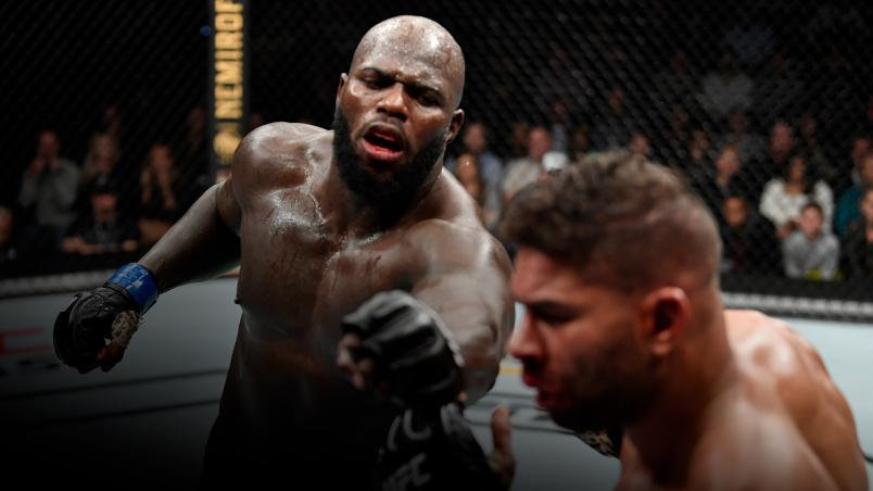Jairzinho Rozenstruik of Suriname punches Alistair Overeem of Netherlands in their heavyweight bout during the UFC Fight Night event at Capital One Arena on December 07, 2019 in Washington, DC. (Photo by Jeff Bottari/Zuffa LLC)