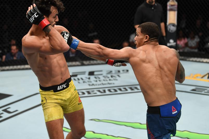 MINNEAPOLIS, MN - JUNE 29: (R-L) Journey Newson punches Ricardo Ramos of Brazil in their bantamweight bout during the UFC Fight Night event at the Target Center on June 29, 2019 in Minneapolis, Minnesota. (Photo by Josh Hedges/Zuffa LLC/Zuffa LLC via Getty Images)