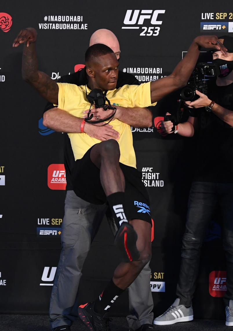 Israel Adesanya of Nigeria poses on stage during the UFC 253 weigh-in on September 25, 2020 at Flash Forum on UFC Fight Island, Abu Dhabi, United Arab Emirates. (Photo by Josh Hedges/Zuffa LLC)