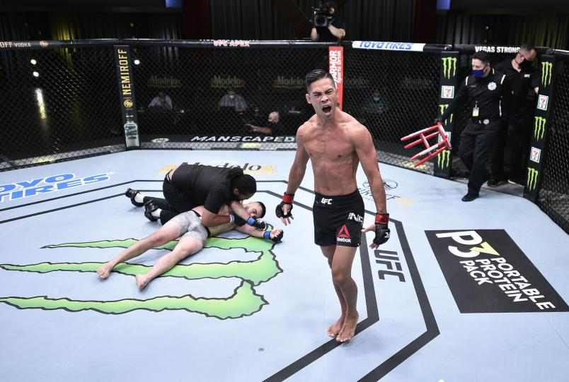 Tyson Nam reacts after his knockout victory over Zarrukh Adashev of Uzbekistan in their bantamweight fight during the UFC Fight Night event at UFC APEX on June 13, 2020 in Las Vegas, Nevada. (Photo by Chris Unger/Zuffa LLC)