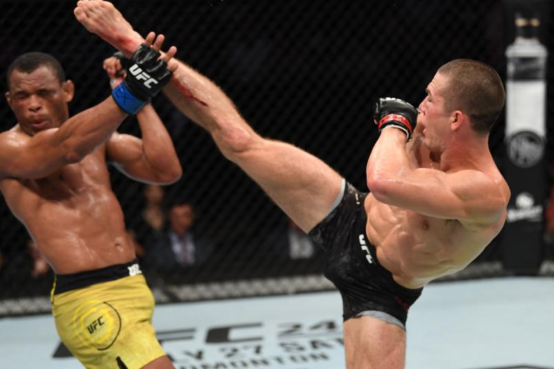 Alexander Hernandez kicks Francisco Trinaldo of Brazil in their lightweight bout during the UFC Fight Night event at AT&T Center on July 20, 2019 in San Antonio, Texas. (Photo by Josh Hedges/Zuffa LLC)