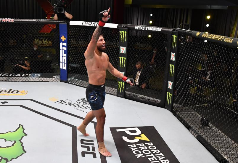 In this handout image provided by UFC, Chris Gutierrez celebrates after his TKO victory over Vince Morales in their featherweight fight during the UFC Fight Night event at UFC APEX on May 30, 2020 in Las Vegas, Nevada. (Photo by Jeff Bottari/Zuffa LLC via Getty Images)