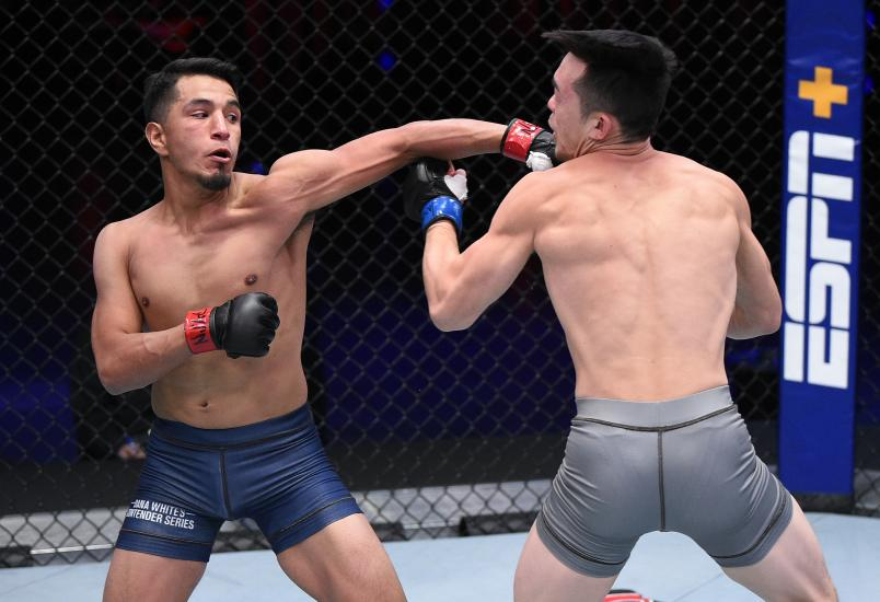 Adrian Yanez punches Brady Huang in a bantamweight fight during week two of Dana White's Contender Series season four at UFC APEX on August 11, 2020 in Las Vegas, Nevada. (Photo by Chris Unger/DWCS LLC/Zuffa LLC)