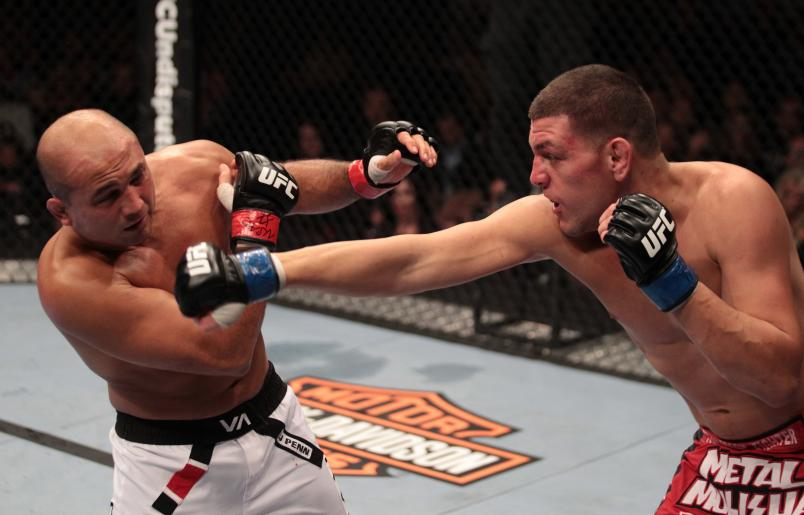 LAS VEGAS, NV - OCTOBER 29: (R-L) Nick Diaz punches BJ Penn during the UFC 137 event at the Mandalay Bay Events Center on October 29, 2011 in Las Vegas, Nevada. (Photo by Jed Jacobsohn/Zuffa LLC/Zuffa LLC via Getty Images)