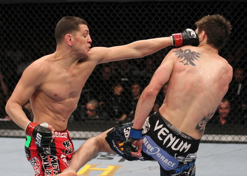 LAS VEGAS, NV - FEBRUARY 04: (L-R) Nick Diaz punches Carlos Condit during the UFC 143 event at Mandalay Bay Events Center on February 4, 2012 in Las Vegas, Nevada. (Photo by Nick Laham/Zuffa LLC/Zuffa LLC via Getty Images)