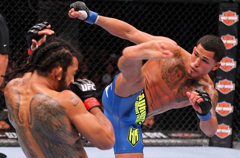 MILWAUKEE, WI - AUGUST 31: (R-L) Anthony Pettis kicks Benson Henderson in their UFC lightweight championship bout at BMO Harris Bradley Center on August 31, 2013 in Milwaukee, Wisconsin. (Photo by Ed Mulholland/Zuffa LLC/Zuffa LLC via Getty Images)