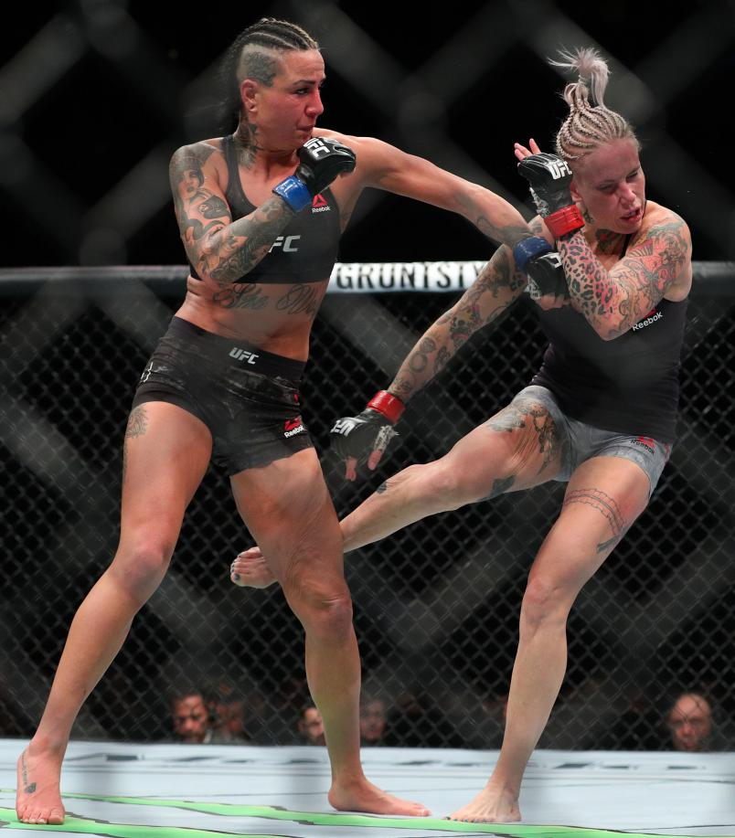 Ashlee Evans-Smith (L) lands a left hand to the head of Bec Rawlings (R) during their flyweight bout at UFC 223 at Barclays Center on April 7, 2018 in New York City. (Photo by Ed Mulholland/Getty Images)