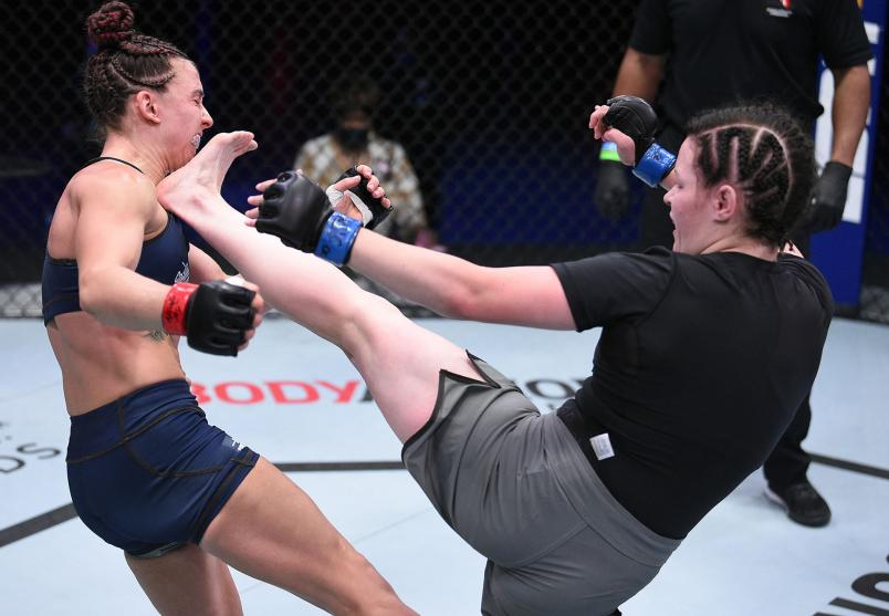 Cory McKenna kicks Vanessa Demopoulos in a strawweight fight during week two of Dana White's Contender Series season four at UFC APEX on August 11, 2020 in Las Vegas, Nevada. (Photo by Chris Unger/DWCS LLC/Zuffa LLC)