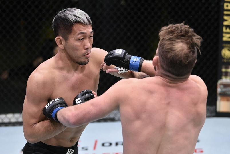 Takashi Sato of Japan punches Jason Witt in their welterweight fight during the UFC Fight Night event at UFC APEX on June 27, 2020 in Las Vegas, Nevada. (Photo by Chris Unger/Zuffa LLC)