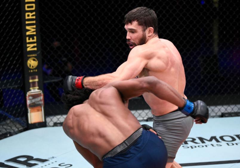 LAS VEGAS, NEVADA - NOVEMBER 17: (R-L) Tucker Lutz punches Sherrard Blackledge in a lightweight bout during Dana White's Contender Series season four week ten at UFC APEX on November 17, 2020 in Las Vegas, Nevada. (Photo by Chris Unger/DWCS LLC)