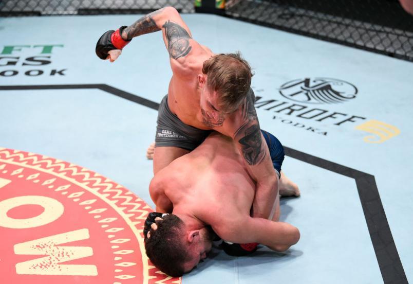 LAS VEGAS, NEVADA - NOVEMBER 17: (L-R) JP Buys punches Jacob Silva in a flyweight bout during Dana White's Contender Series season four week ten at UFC APEX on November 17, 2020 in Las Vegas, Nevada. (Photo by Chris Unger/DWCS LLC)