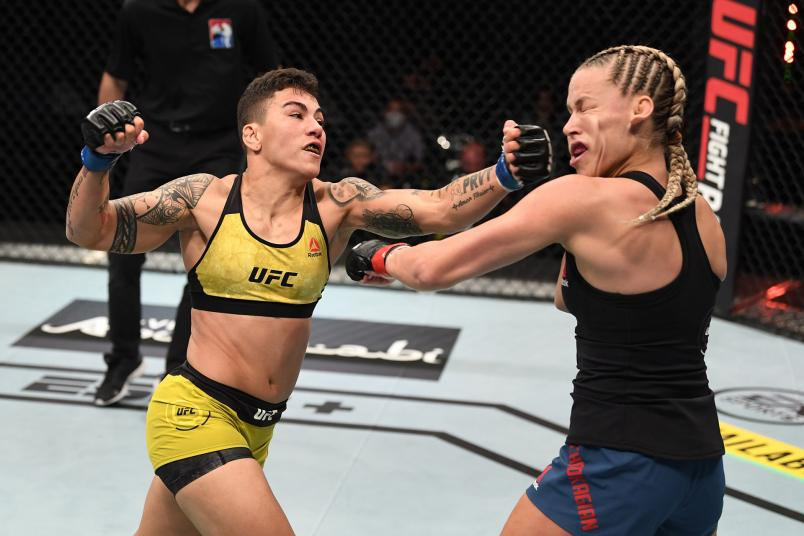 Jessica Andrade of Brazil punches Katlyn Chookagian in their women's flyweight bout during the UFC Fight Night event inside Flash Forum on UFC Fight Island on October 18, 2020 in Abu Dhabi, United Arab Emirates. (Photo by Josh Hedges/Zuffa LLC)