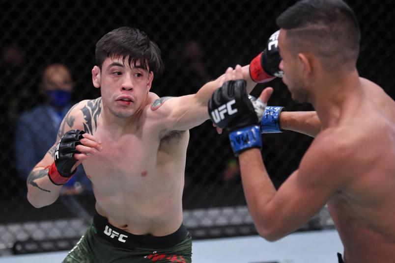 Brandon Moreno of Mexico punches Brandon Royval in their flyweight bout during the UFC 255 event at UFC APEX on November 21, 2020 in Las Vegas, Nevada. (Photo by Jeff Bottari/Zuffa LLC)