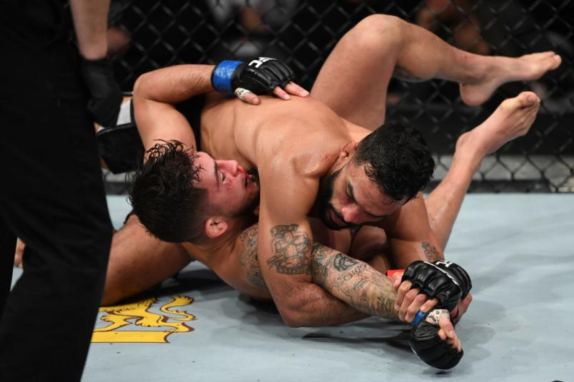 MILWAUKEE, WISCONSIN - DECEMBER 15: (R-L) Rob Font attempts to submit Sergio Pettis in their bantamweight bout during the UFC Fight Night event at Fiserv Forum on December 15, 2018 in Milwaukee, Wisconsin. (Photo by Jeff Bottari/Zuffa LLC)