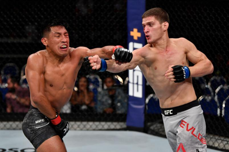 SINGAPORE, SINGAPORE - OCTOBER 26: (R-L) Movsar Evloev of Russia punches Enrique Barzola of Peru in their featherweight bout during the UFC Fight Night event at Singapore Indoor Stadium on October 26, 2019 in Singapore. (Photo by Jeff Bottari/Zuffa LLC)
