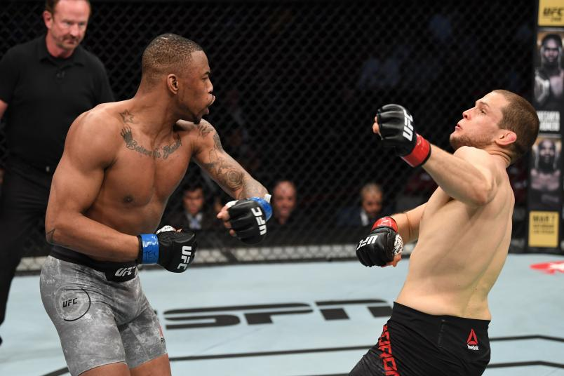 Khaos Williams punches Alex Morono in their welterweight bout during the UFC 247 event at Toyota Center on February 08, 2020 in Houston, Texas. (Photo by Josh Hedges/Zuffa LLC via Getty Images)