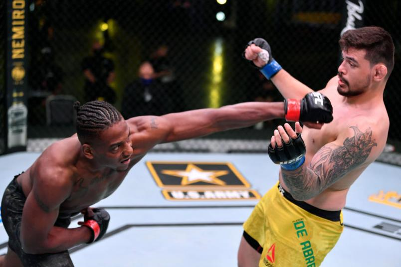 LAS VEGAS, NEVADA - MAY 30: (L-R) Jamahal Hill punches Klidson Abreu of Brazil in their light heavyweight fight during the UFC Fight Night event at UFC APEX on May 30, 2020 in Las Vegas, Nevada. (Photo by Jeff Bottari/Zuffa LLC)